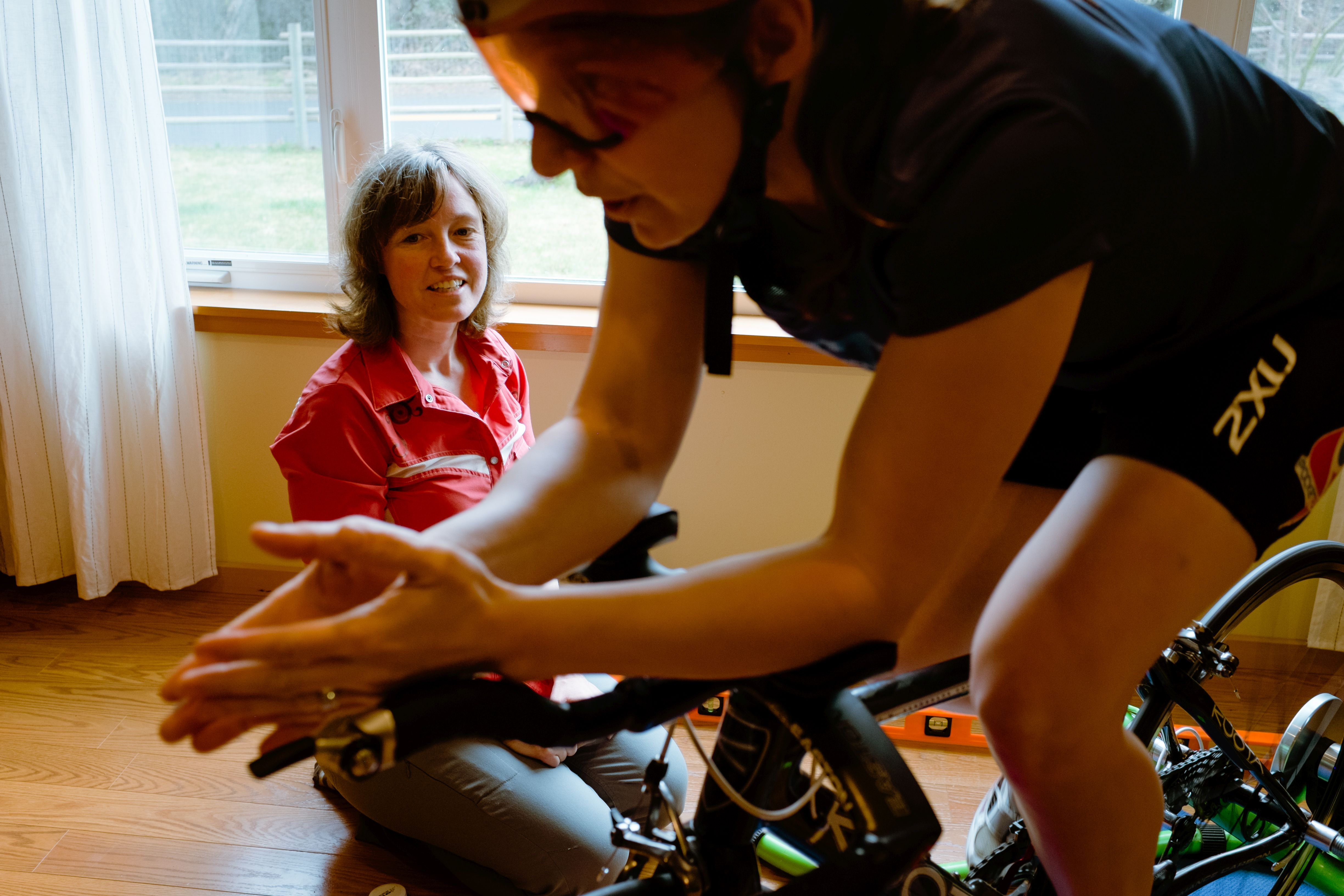 Cassie consulting about tri position and helmet with a client